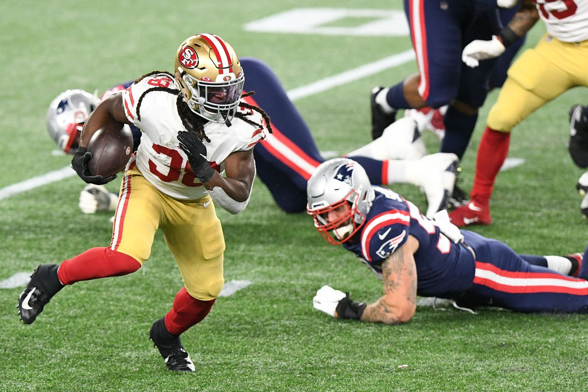 San Francisco 49ers running back JaMycal Hasty runs with the ball against the New England Patriots during the second half at Gillette Stadium.