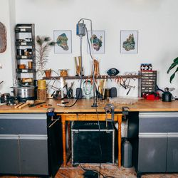 """Our workbench is where most of the magic happens, and we like to be surrounded by things that inspire us. The """"9"""" was a gift from our best friend and artist <a href=""""http://www.melissacarroll.com/"""">Melissa Carroll</a>—it's kind of a secret code between th"""