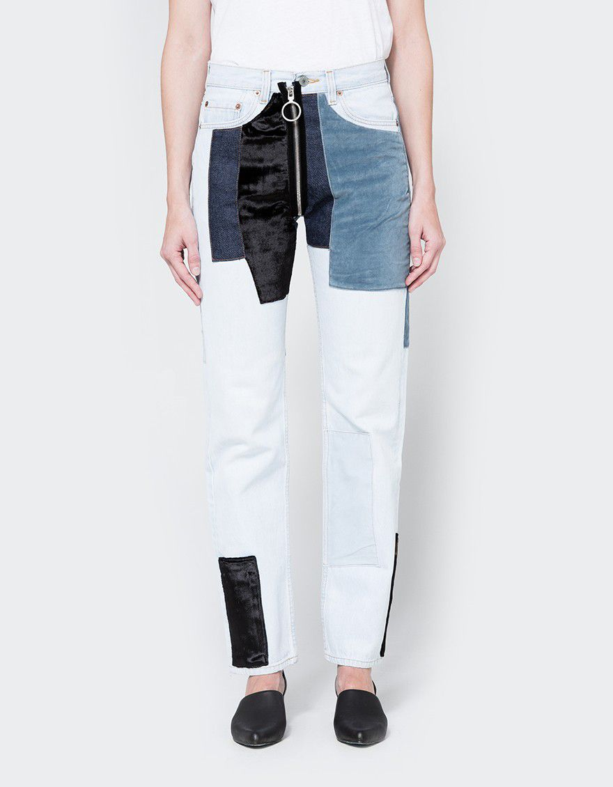 velvet-patched jeans with circle zipper pull