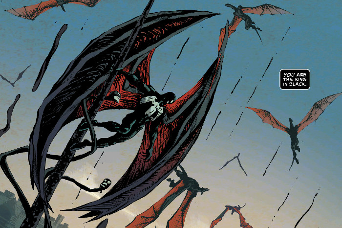 Eddie Brock, as Venom but with massive red and black dragon wings, takes a pose over a liberated New York City as symbiotes and symbiote dragons swarm around him worshipfully in King in Black #5, Marvel Comics (2021).