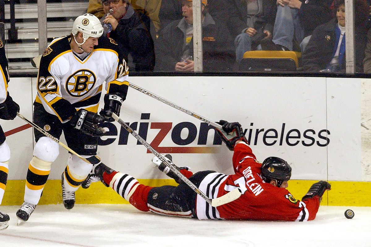 (1/30/03 Boston, MA) Boston Bruins vs the Chicago Blackhawks. The Bruins @22Michal Grosek takes down #7Lyle Odelein in the 1st period.(013003bruinsmjs-staff photo by Michael Seamans. Saved in photo Friday/cd.)