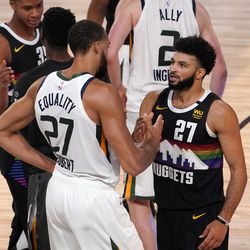 Utah Jazz's Rudy Gobert (27) and Denver Nuggets' Jamal Murray, right, talk after their NBA first round playoff basketball game, Tuesday, Sept. 1, 2020, in Lake Buena Vista, Fla. The Nuggets won 80-78.