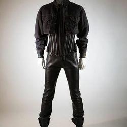 Man's black leather ensemble: Levis jacket, Mr. Pearl corset, Abel Villarreal pant, and custom Weco boots, worn by Scott Ewalt, 1990s.