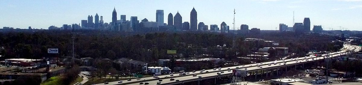 A overview of Atlanta and Atlantic Station with many trees in between.