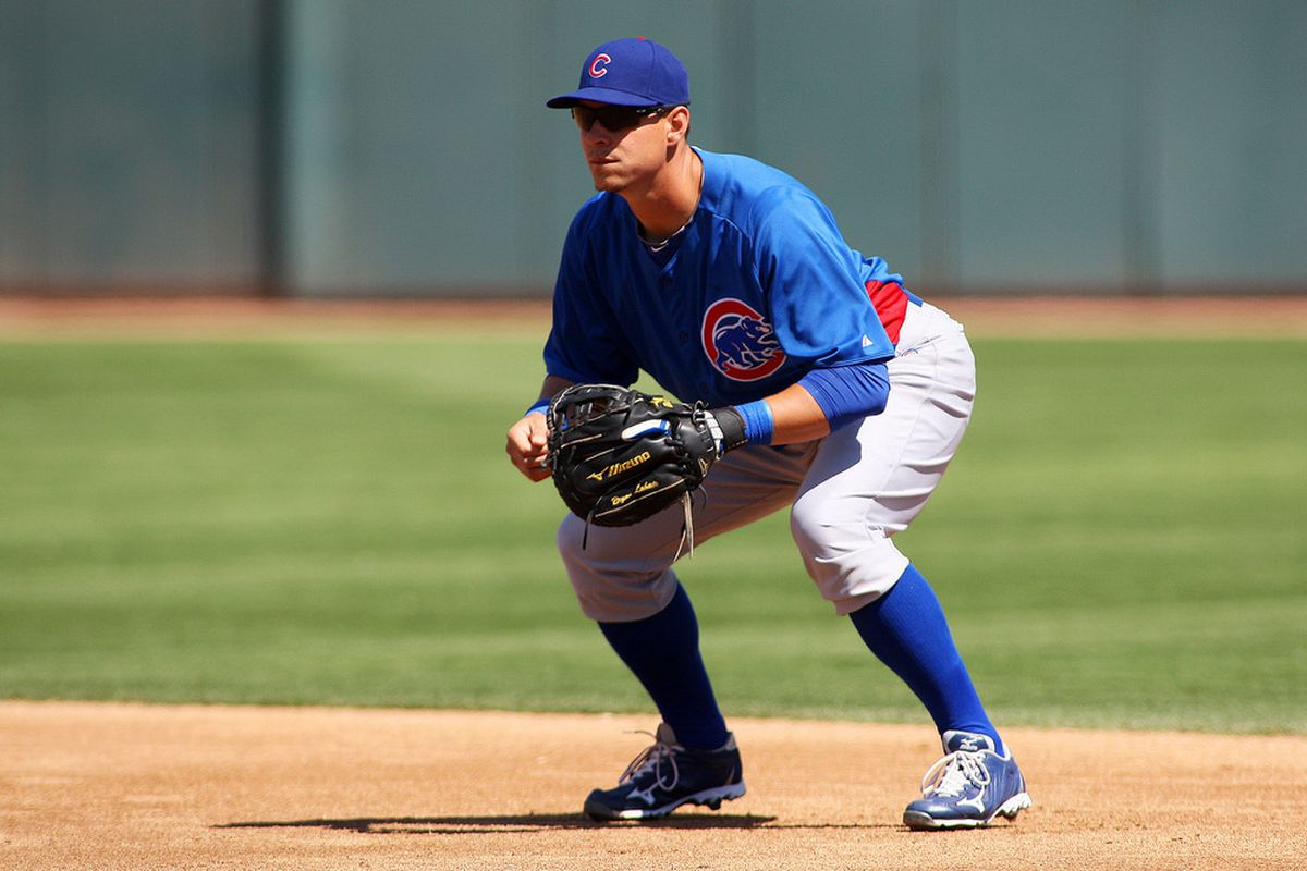 Phoenix, AZ, USA; Chicago Cubs first baseman Bryan LaHair in the field during the first inning against the Oakland Athletics at Phoenix Municipal Stadium. Credit: Jake Roth-US PRESSWIRE