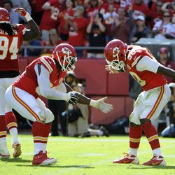 Kansas City Chiefs outside linebacker Tamba Hali (left) celebrates with outside linebacker Justin Houston (50) after a sack against the Oakland Raiders in the second half at Arrowhead Stadium. Kansas City won the game 24-7.