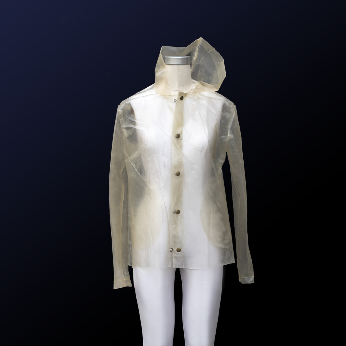 A transparent raincoat with a yellow hue made from algae plastic