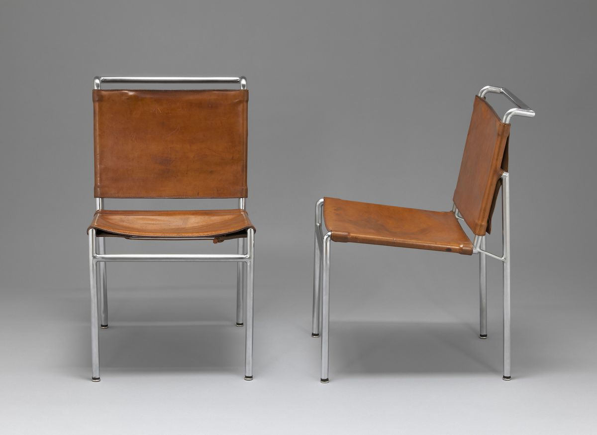 Two steel and leather chairs.