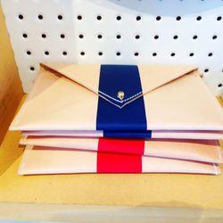 Clare V's famed striped pouchettes, $88 (regular $175).