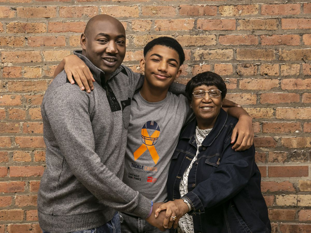 Kenyon Caldwell, 15, with Dad Maurice Caldwell and Grandmother Zenia Caldwell.   Rich Hein/Sun-Times