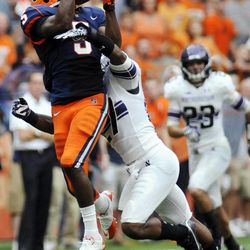Syracuse's Marcus Sales (5) makes a catch while being defended by Northwestern's Jared Carpenter (27) during the fourth quarter of an NCAA college football game in Syracuse, N.Y., Saturday, Sept. 1, 2012. Northwestern won 42-41.