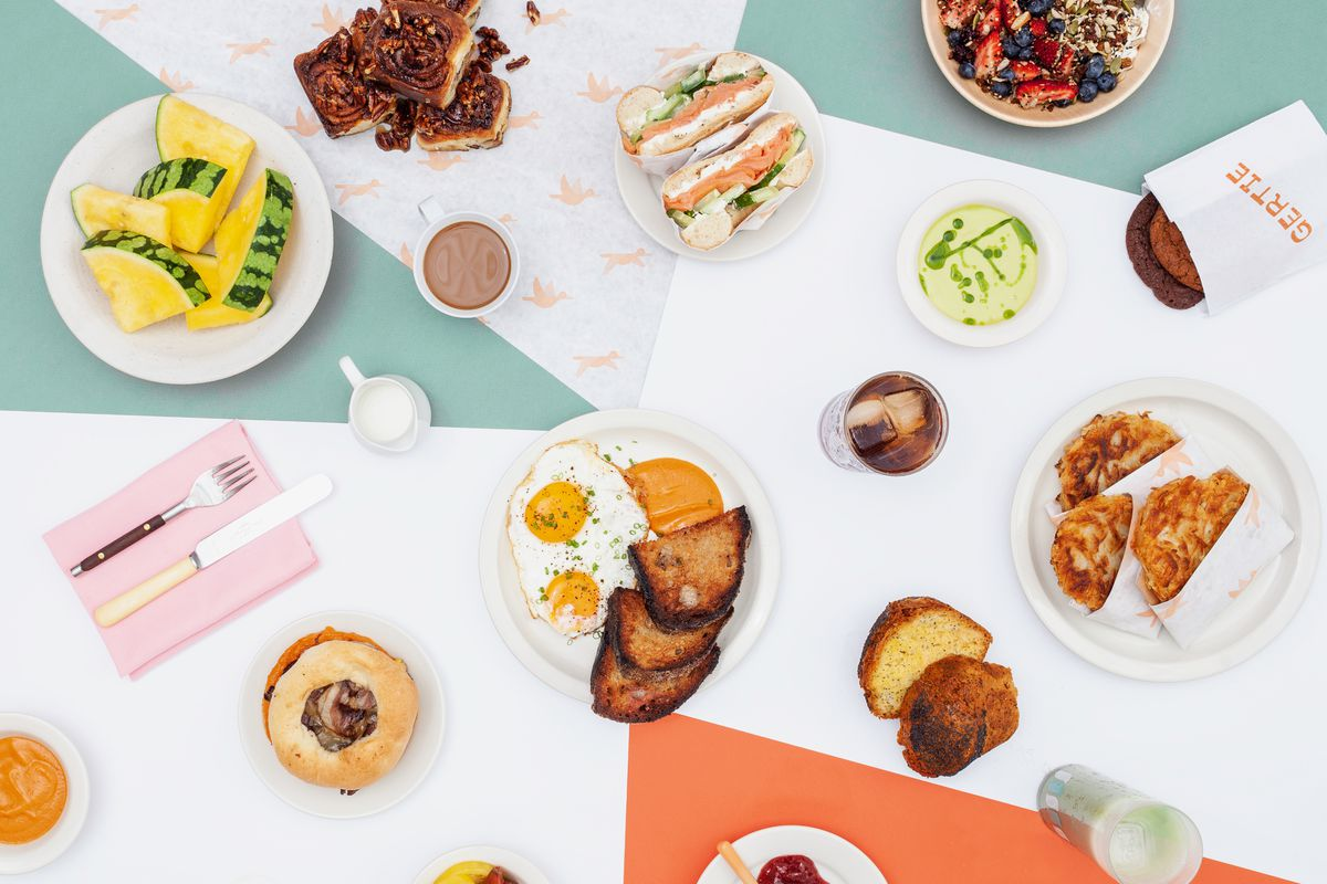 A colorful breakfast spread at Gertie, on a patterned geometric tablecloth.