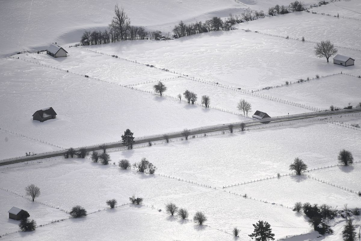 Snow covers the landscape with low temperatures after the recent snow fall, in Belagua valley near to Isaba, northern Spain, Tuesday, Jan. 12, 2021.