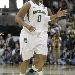 Baylor guard Odyssey Sims (0) smiles as she runs off the court after an NCAA women's Final Four semifinal college basketball game against Stanford in Denver, Sunday, April 1, 2012. Baylor defeated Stanford 59-47.