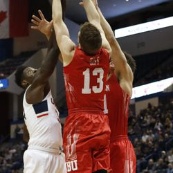 UConn's David Onuorah (34) battles for a rebound with two Boston University defenders.