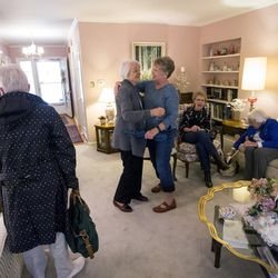 Former Utah First Lady Norma Matheson hugs Diane Hale at their monthly book club at the home of Carol McFarland on Thursday, April 20, 2017.