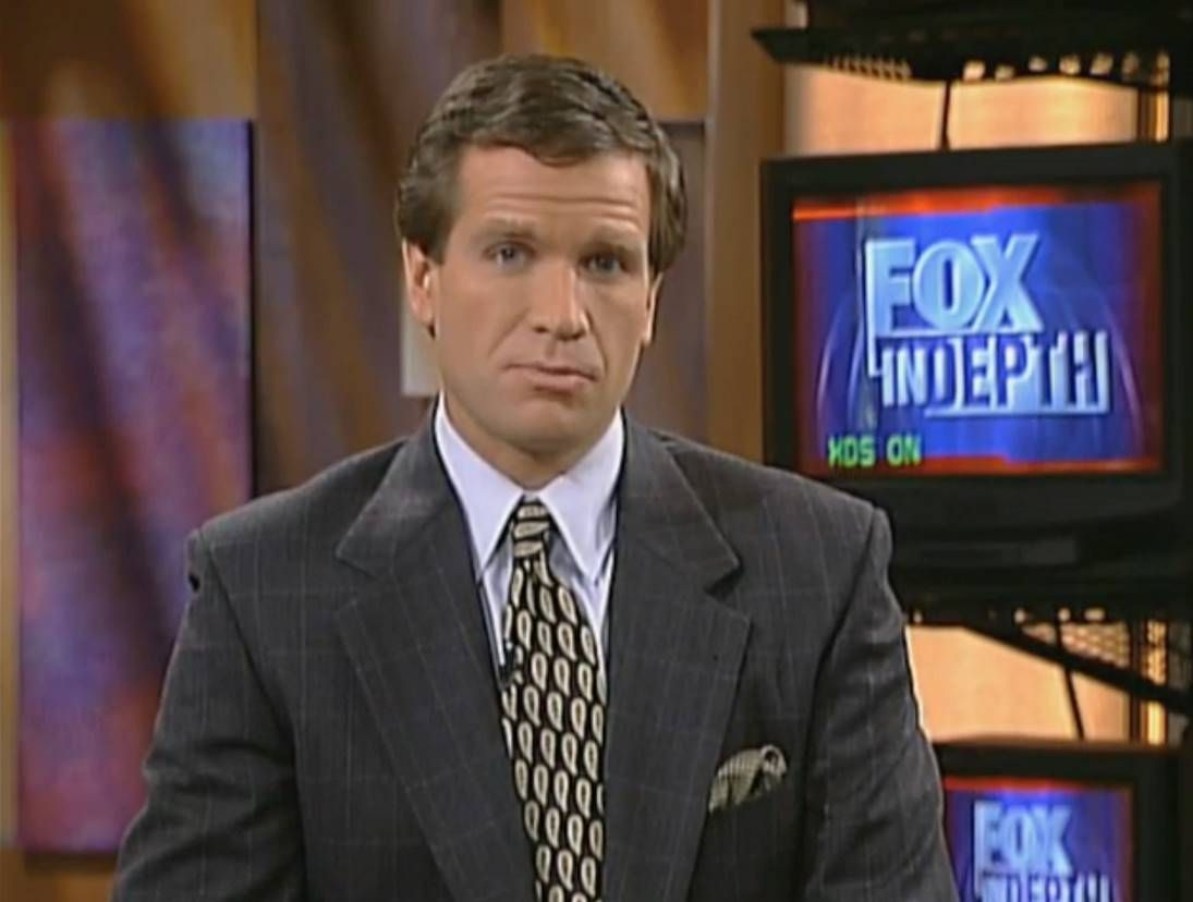 """""""Fox Report"""" anchor Jon Scott is pictured on the Fox News Channel in 1996."""
