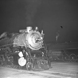 This is the President's locomotive at Union Station in 1936, awaiting the President signal for departure to California after the funeral of former Utah Governor George H. Dern.