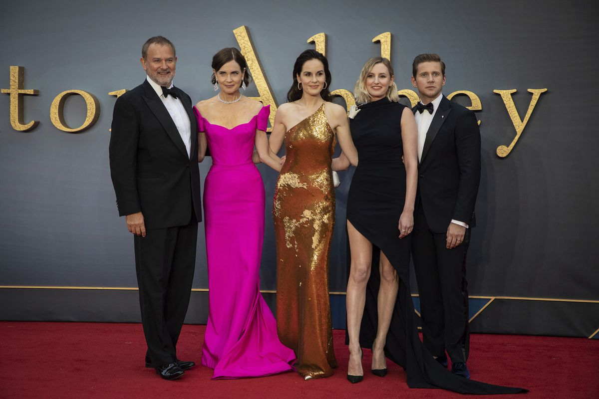 """Actors Hugh Bonneville (from left), Elizabeth McGovern, Michelle Dockery, Laura Carmichael and Allen Leech pose for photographers upon arrival at the world premiere of the film """"Downton Abbey"""" in London on Monday."""