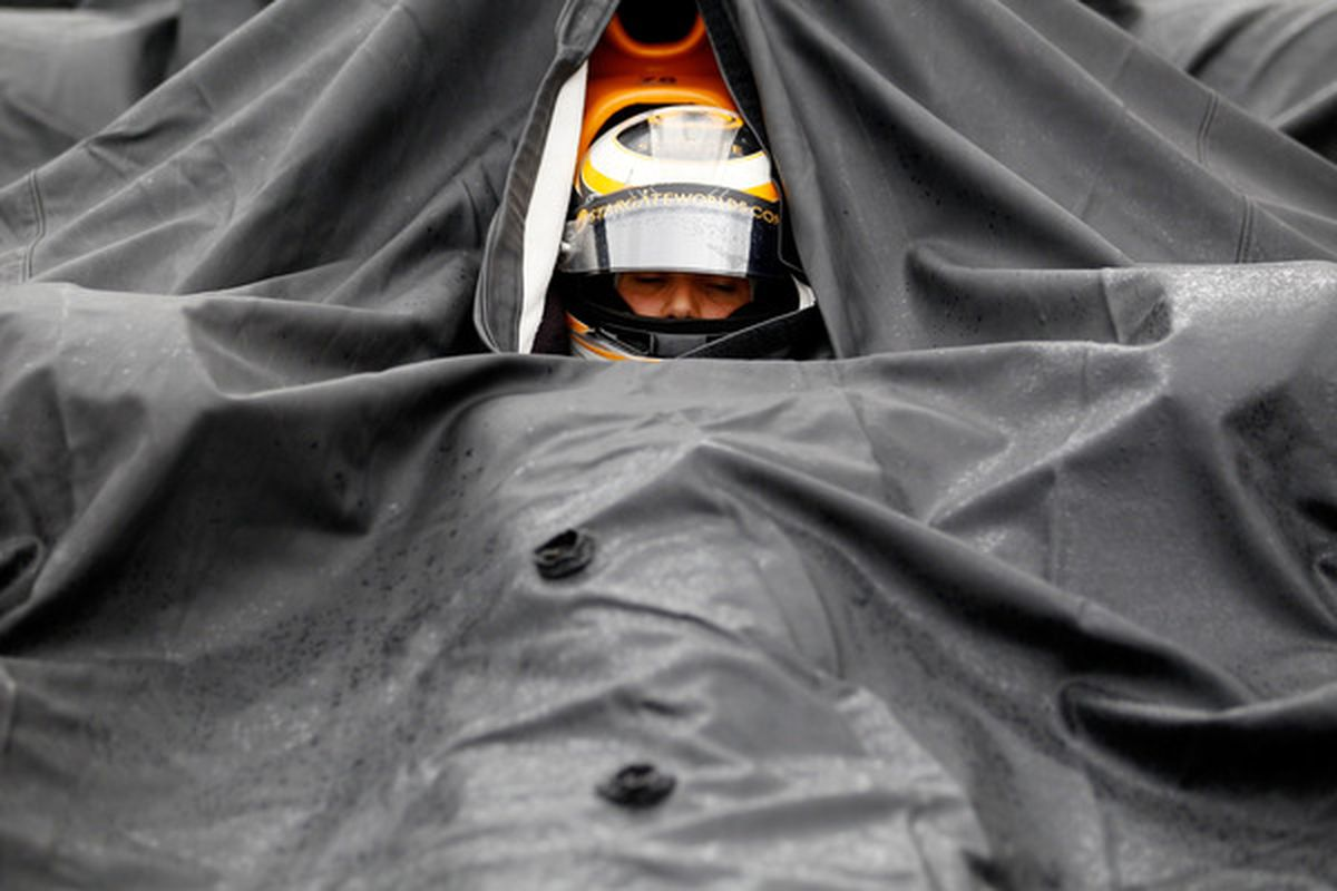 SPARTA KY - SEPTEMBER 03:  Simona De Silvestro of Switzerland driver of the #67 Team Stargate Worlds HVM Racing Dallara Honda sits in her car during a rain delay on September 3 2010 in Sparta Kentucky.  (Photo by Chris Graythen/Getty Images)