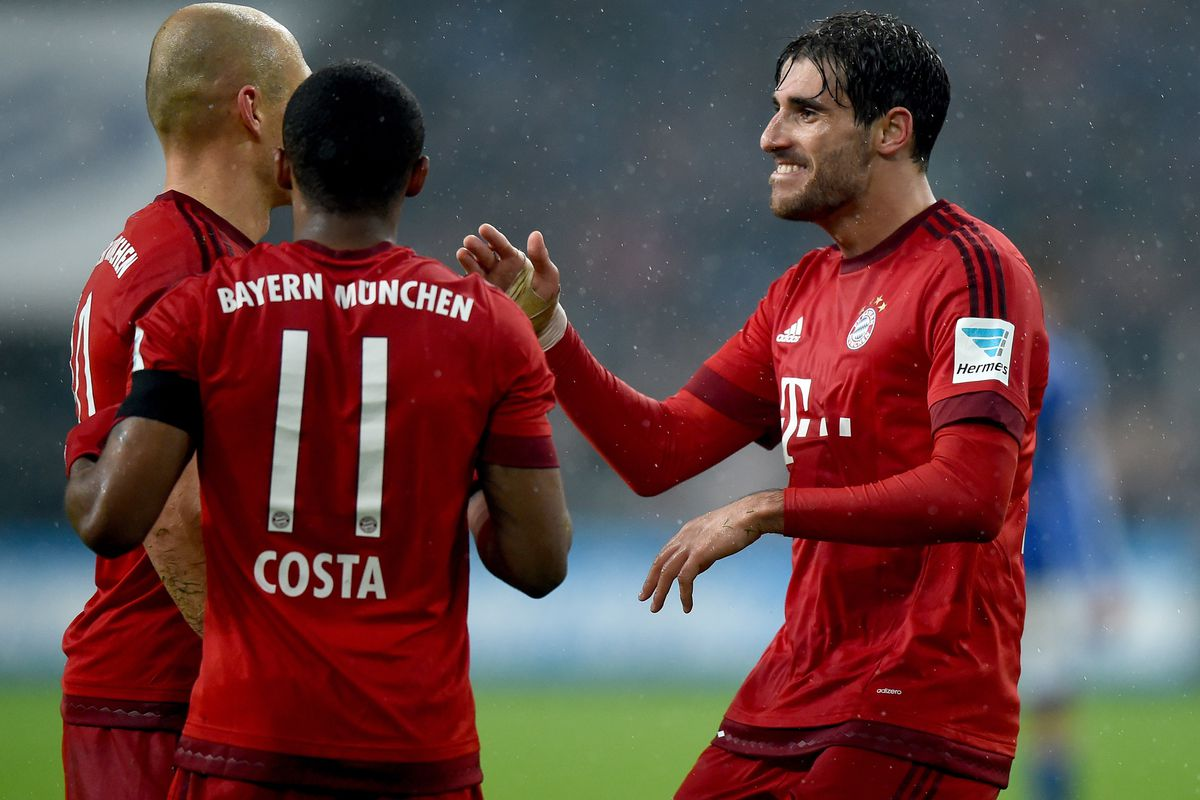 Javi Martinez is congratulated by his teammates for his game-winning goal in the 69th minute