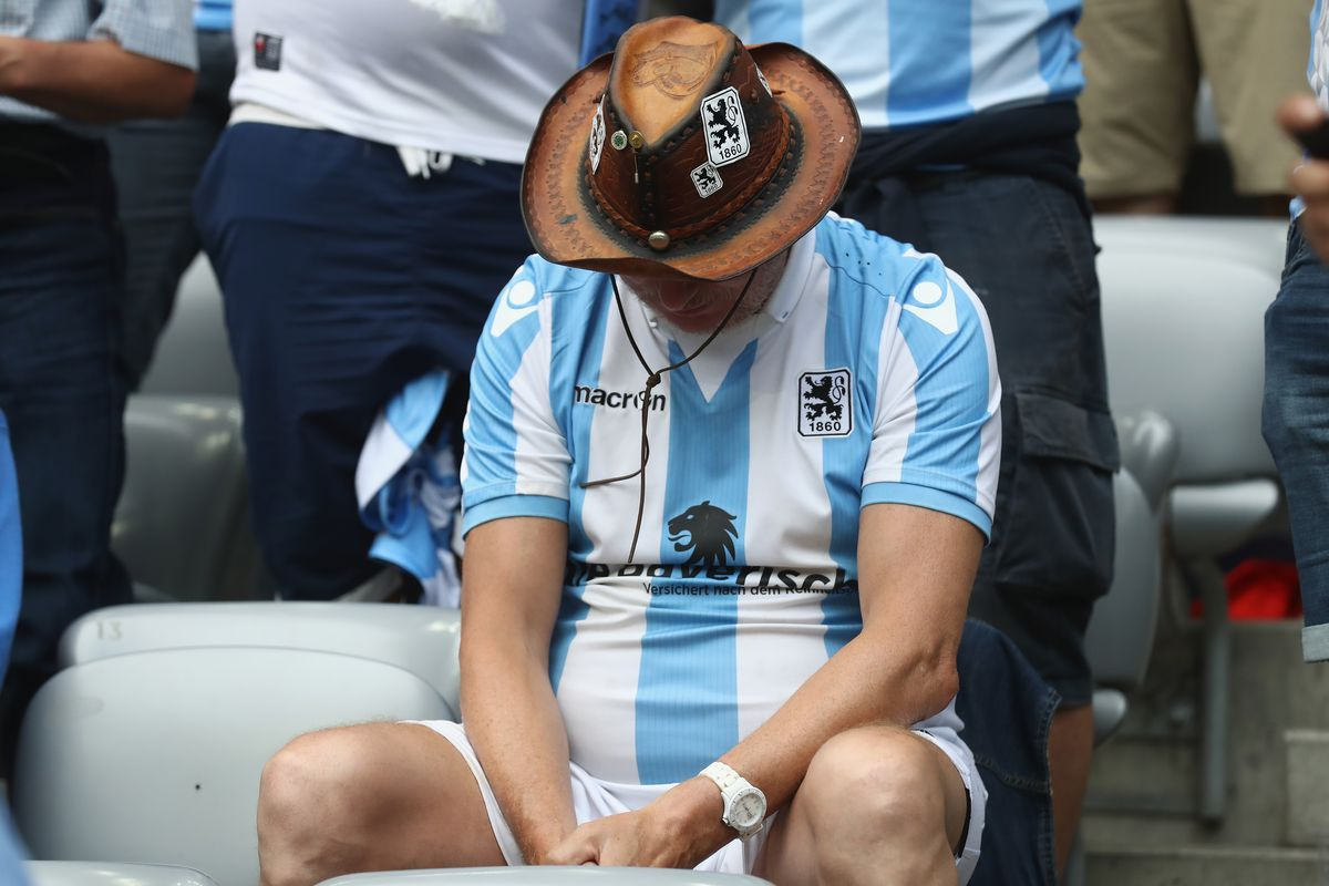 MUNICH, GERMANY - MAY 30: A supporter of 1860 Muenchen looks dejected during the Second Bundesliga Playoff second leg match betweenTSV 1860 Muenchen and Jahn Regensburg at Allianz Arena on May 30, 2017 in Munich, Germany.