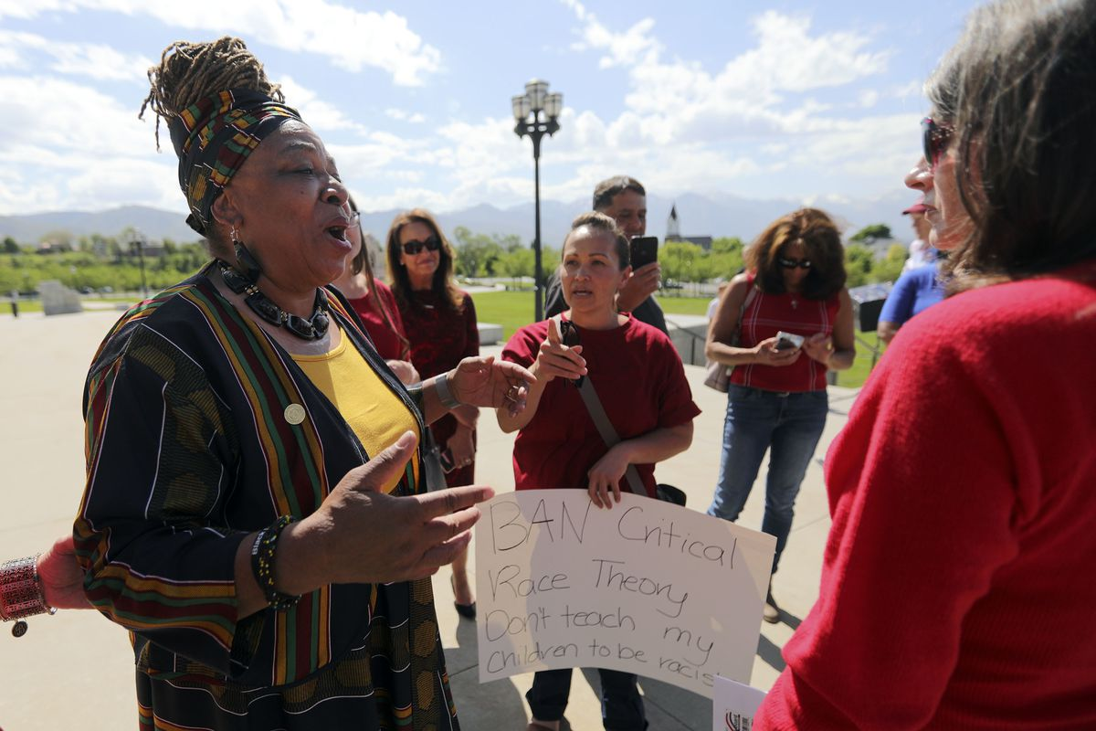 Betty Sawyer, left, a supporter of critical race theory, exchanges views with a group of women opposed to the theory outside of the Capitol in Salt Lake City on May 19.