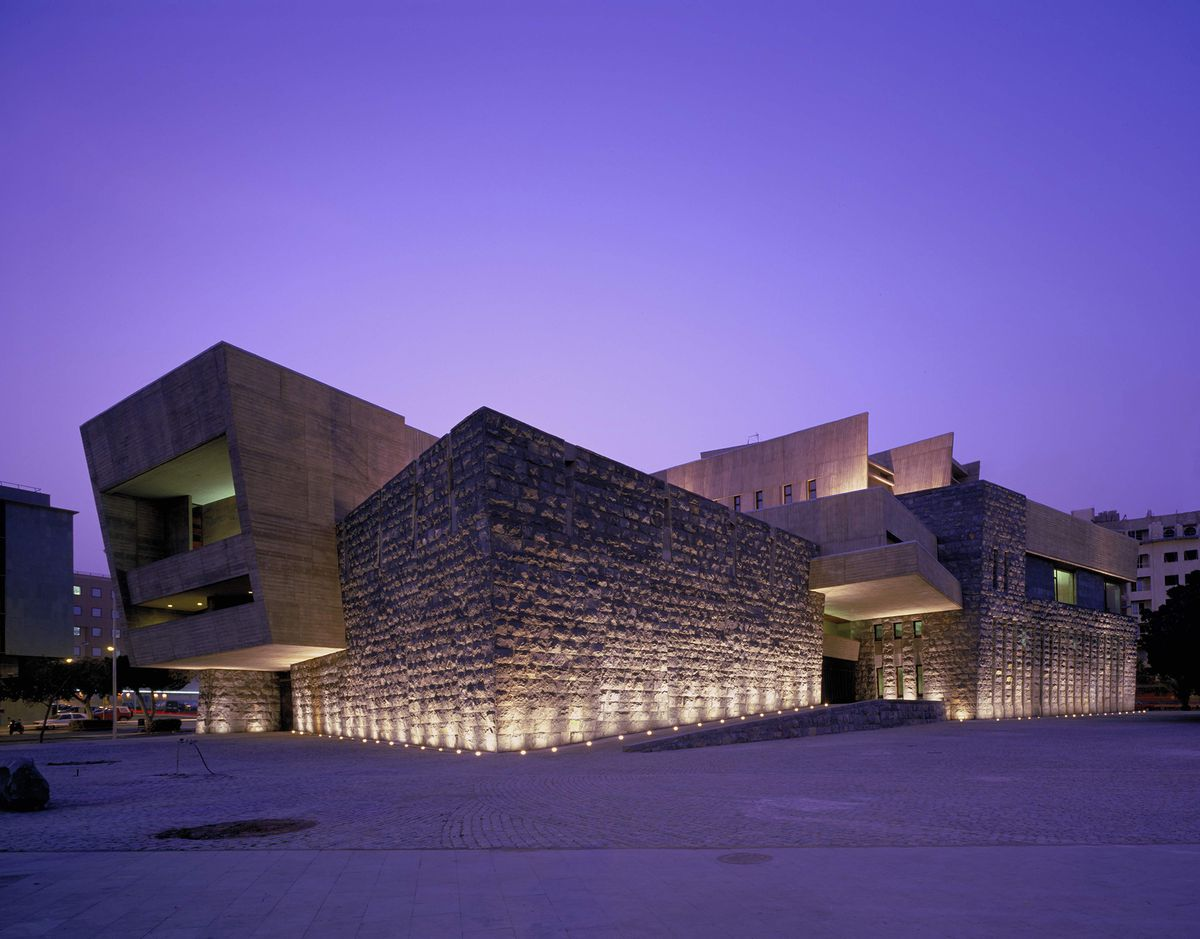 The exterior of the Presidential Building of the Government of the Canary Islands. The facade is concrete, stone, and wood.
