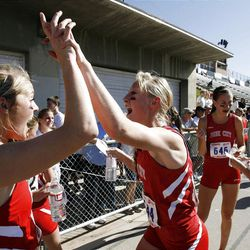 Park City's Ali Walker, left, and Annie Orr celebrate their team's win in the 3A girls state cross country high school race.