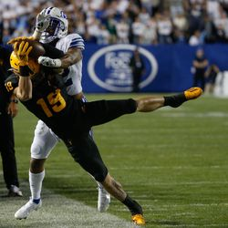 Arizona State defensive back Willie Harts (19) gets pressed by Brigham Young defensive back Malik Moore by the sideline during an NCAA college football game at LaVell Edwards Stadium in Provo on Saturday, Sept. 18, 2021.