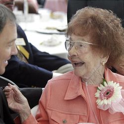 104-year-old Century Club centenarian Marguerite Flickinger from Ogden laughs with Gov. Gary Herbert during a celebration in Salt Lake City on Friday.