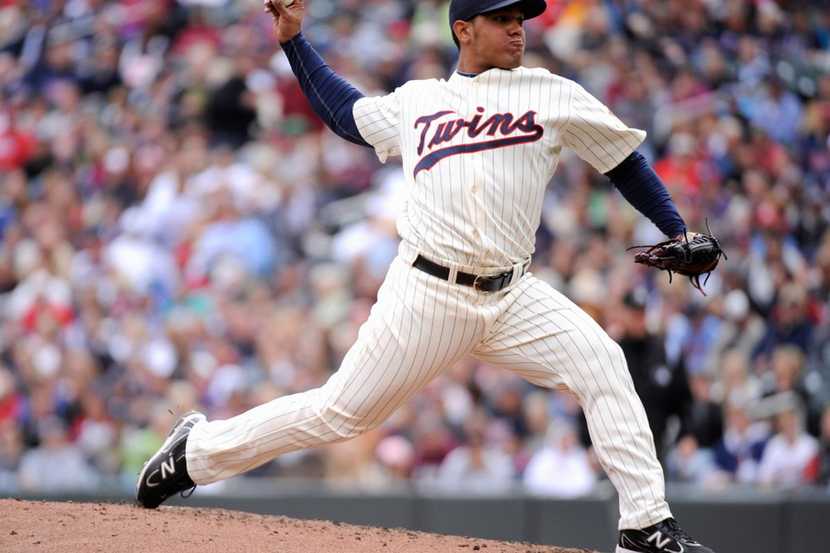 MINNEAPOLIS, MN - SEPTEMBER 17: Lester Oliveros #17 of the Minnesota Twins delivers a pitch against the Cleveland Indians in the second inning on September 17, 2011 at Target Field in Minneapolis, Minnesota. (Photo by Hannah Foslien/Getty Images)