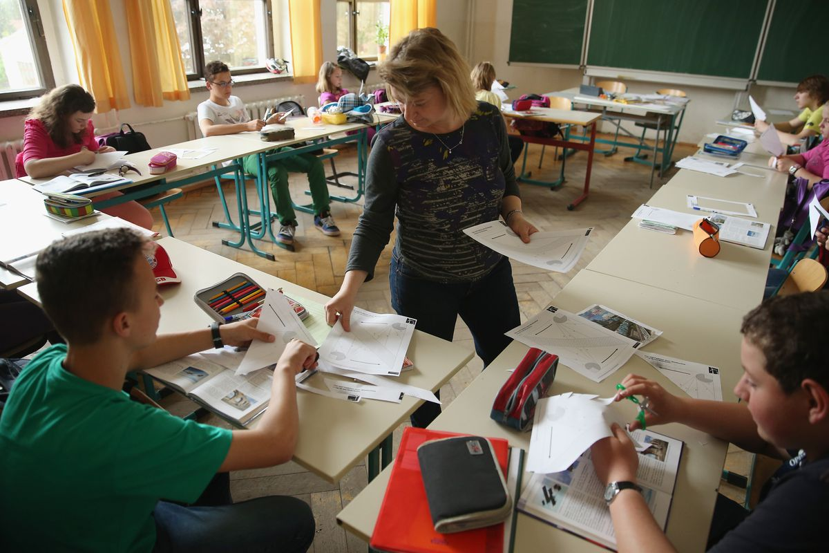 A teacher with her students in Germany, once a model for the American education system.