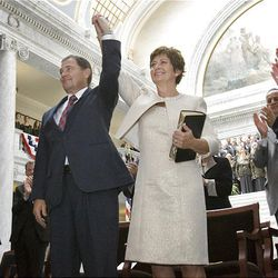 Gov. Gary Herbert and his wife, Jeanette, hold hands after Herbert took the oath of office from Utah Supreme Court Chief Justice Christine Durham, right.