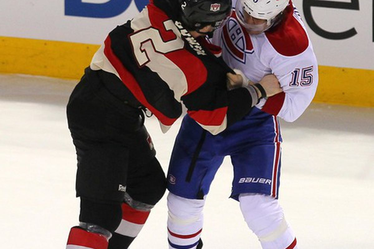 Mar 14, 2012; Montreal, QC, CAN;  Ottawa Senators defenseman Jared Cowen (2) and Montreal Canadiens center Petteri Nikolainen (15) fight during the first period at the Bell Center. Mandatory Credit: Jean-Yves Ahern-US PRESSWIRE