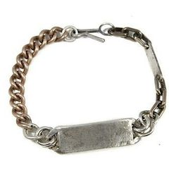 """<strong>In God We Trust</strong> Heavy Metal Thick ID Bracelet, <a href=""""http://ingodwetrustnyc.com/collections/new-jewelry-collections/products/heavy-metal-thick-id-bracelet"""">$270</a>"""