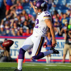 Aug 16, 2013; Orchard Park, NY, USA;  Minnesota Vikings punter Jeff Locke (12) punts the ball during the first quarter against the Buffalo Bills at Ralph Wilson Stadium.