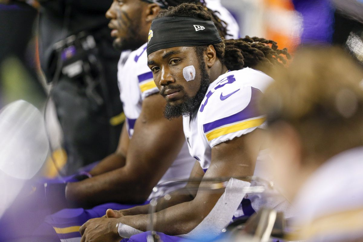 Minnesota Vikings running back Dalvin Cook sits on the bench during the third quarter against the Seattle Seahawks at CenturyLink Field.