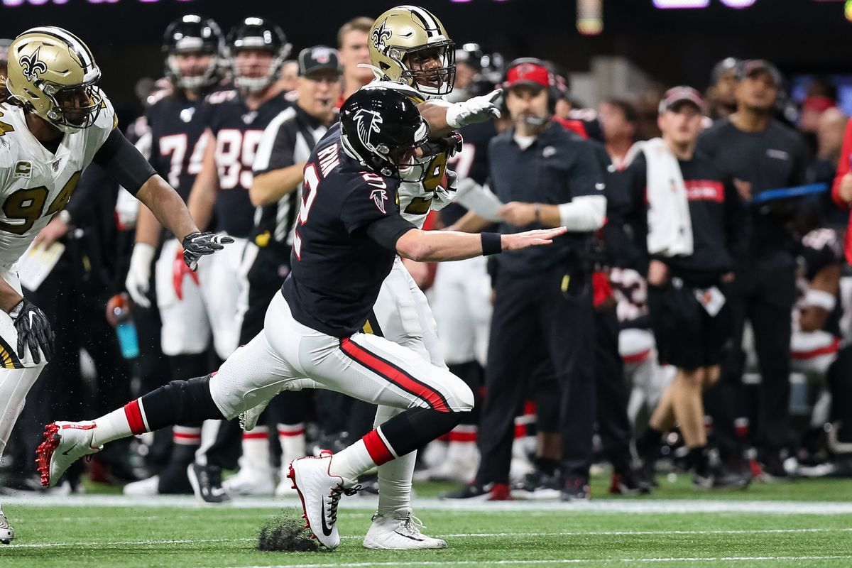 Matt Ryan of the Atlanta Falcons along side Cameron Jordan is unable to tackle Shy Tuttle of the New Orleans Saints during the second half of a game at Mercedes-Benz Stadium on November 28, 2019 in Atlanta, Georgia.