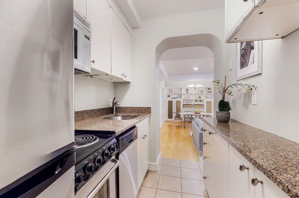 A long, narrow kitchen with counters on both sides.