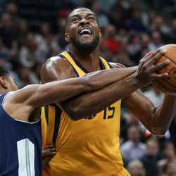 A jump ball is called as Utah Jazz forward Derrick Favors (15) goes to the hoop against Denver Nuggets guard Gary Harris (14) at Vivint Smart Home Arena in Salt Lake City on Tuesday, Nov. 28, 2017.