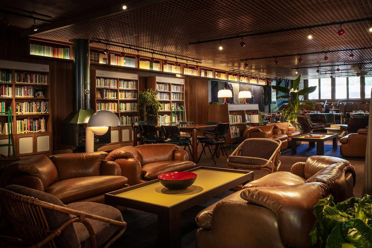 Library filled with leather chairs and books