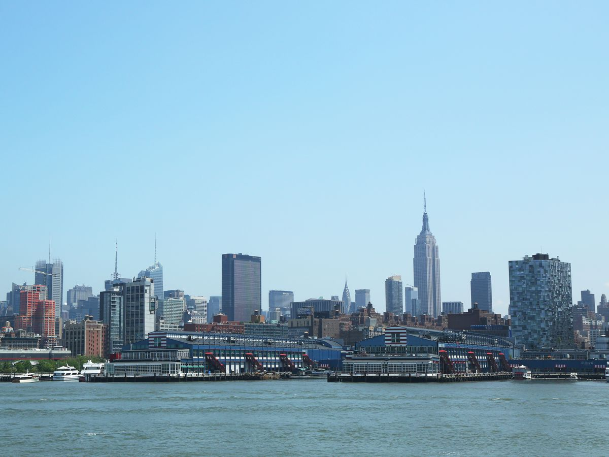 Chelsea Piers in New York City. There are various parts of the piers in front of many tall city buildings.
