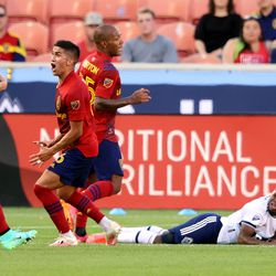 Real Salt Lake midfielder Pablo Ruiz (6) reacts to being called for a foul on Vancouver Whitecaps forward Deiber Caicedo (7) as Real Salt Lake and Vancouver FC play at Rio Tinto Stadium in Sandy on Wednesday, July 7, 2021.