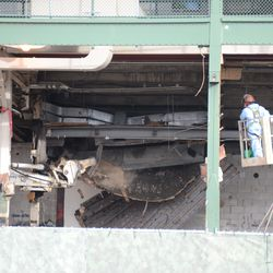 1:26 p.m. Demolition work continues, in the space above the ticket windows -