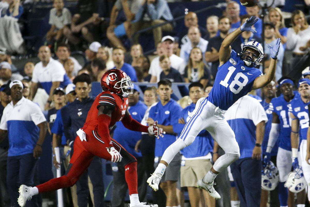 BYU receiver Gunner Romney (18) catches a pass from quarterback Zach Wilson while defended by Utah defensive back Jaylon Johnson.