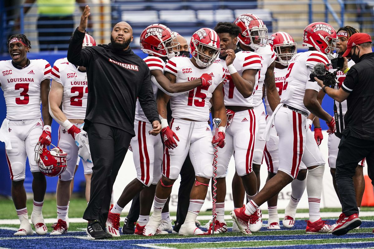 Louisiana-Lafayette Ragin Cajuns celebrate with running back Elijah Mitchell (15) after he scored the winning touchdown against the Georgia State Panthers during overtime at Center parc Stadium.