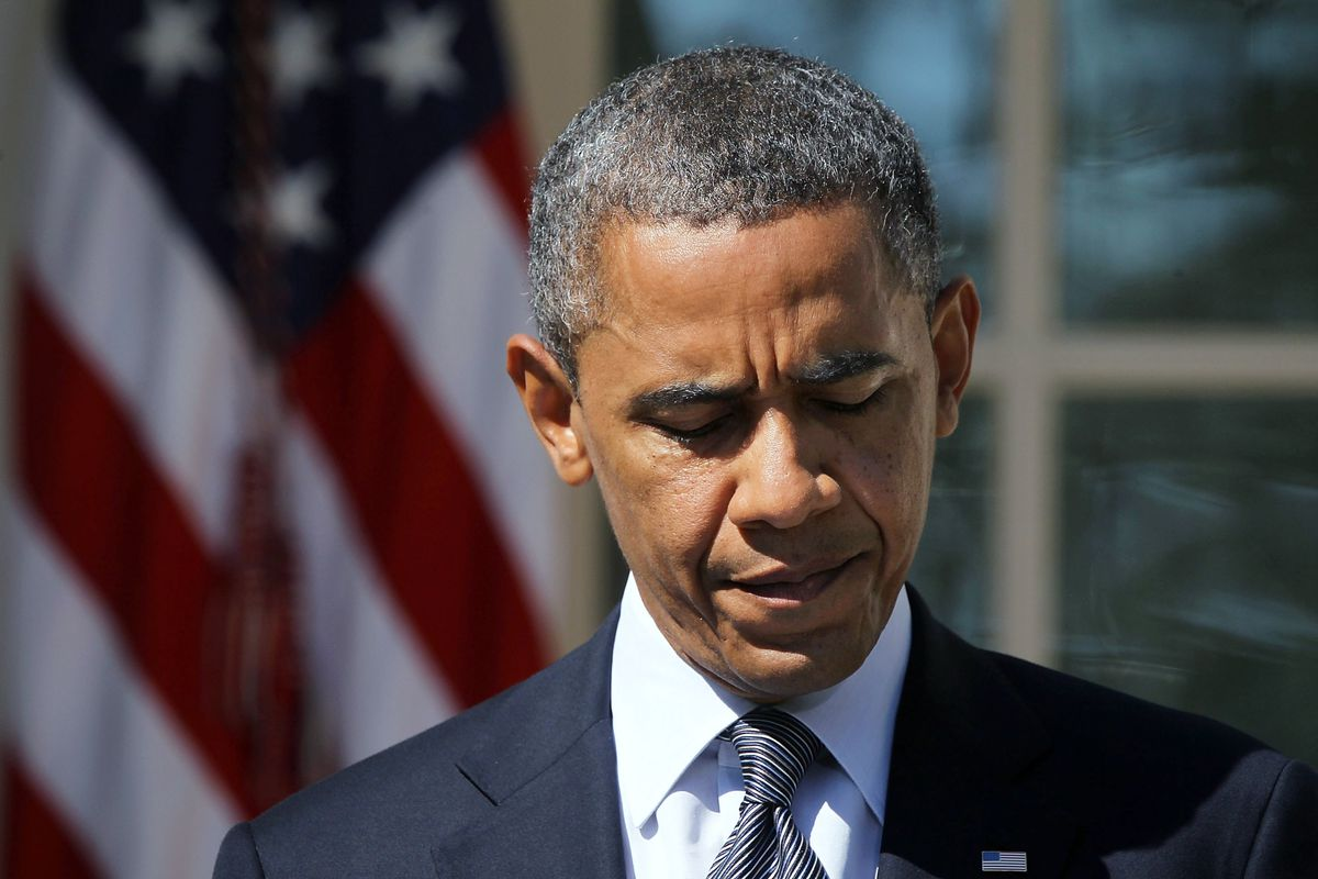 Obama looking down and sad