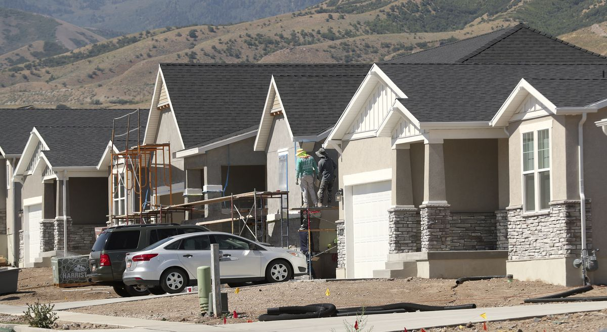 Crews work on home exteriors at C.W. Farms, an Ivory Homes development in Magna, on Wednesday, July 29, 2020. The Salt Lake City metro area is the third-most competitive housing market in the nation, according to a July ranking by Redfin, behind only Boston and San Diego. Robert Spendlove, Zions Bank senior economist, and Mike Gould, mortgage division manager for Zions Bancorporation, talked about the current state of and outlook for Utah's housing market during a press conference at the new subdivision.