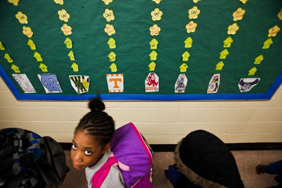 Student gazes at camera.
